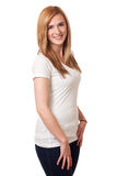 Casual Young Woman. Young woman in white t-shirt and jeans. Studio shot over white Royalty Free Stock Photography