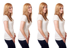 Casual Young Woman. Young woman in white t-shirt and jeans. Studio shot over white Stock Photos