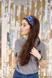 Casual young woman with bandana, pin up style. Casual girl with bandana looking away, classic style Royalty Free Stock Image