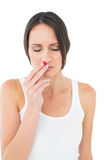 Casual young woman with bleeding nose Royalty Free Stock Photos