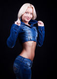 Casual young woman in blue jeans. Portrait of young blonde in blue jeans and jacket Royalty Free Stock Images