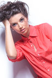 Casual young woman with hand in hair Royalty Free Stock Photography