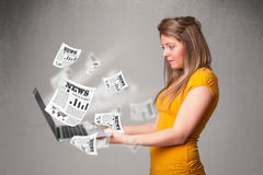 Casual young woman holdin notebook and reading the explosive new Stock Photography