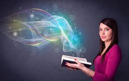 Young lady holding book with waves Royalty Free Stock Image