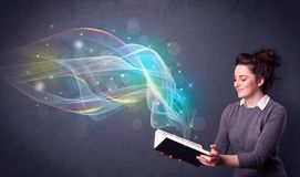 Young lady holding book with waves Stock Photo