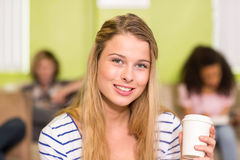 Casual young woman holding disposable cup Royalty Free Stock Photo
