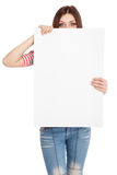 Casual young woman holding a white board Stock Image