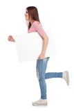 Casual young woman holding a white board Royalty Free Stock Image