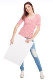 Casual young woman holding a white board Royalty Free Stock Images