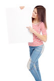 Casual young woman holding a white board Stock Photos