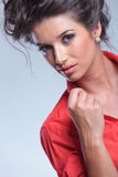 Casual young woman holds her collar Royalty Free Stock Images