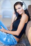 Casual young woman listening to music Stock Photos