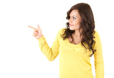 Casual young woman pointing up Stock Photo