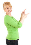 Casual young woman pointing up Stock Photography