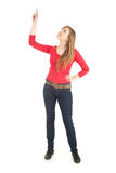 Casual young woman pointing up, full length Royalty Free Stock Images