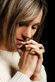Casual young woman praying. Stock Images
