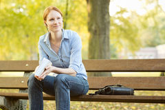 Casual Young Woman Relaxing in a Park Royalty Free Stock Photos