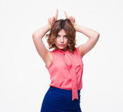 Casual young woman showing rabbit ears Stock Image