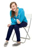 Casual young woman sitting Stock Photography