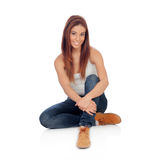 Casual young woman sitting on the floor Stock Photography