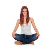 Casual young woman sitting on the floor Royalty Free Stock Photos