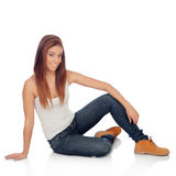 Casual young woman sitting on the floor Royalty Free Stock Photo