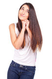 Casual young woman standing and doing funny face Stock Photo