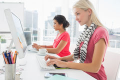 Casual young women using computers in office Stock Photo
