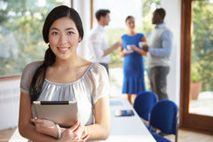 Casually Dressed Businesswoman At Meeting In Boardroom Royalty Free Stock Photography