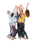 Casually dressed happy young people raising hands Stock Image