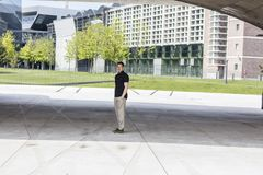 Casually Dressed Man Standing in Front of Office Buildings. In Frankfurt, Germany Stock Photos