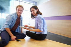 Casually dressed man and woman working together Stock Photos
