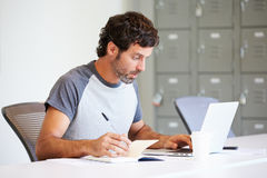 Casually Dressed Man Working In Design Studio Royalty Free Stock Image