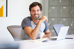 Casually Dressed Man Working In Design Studio Stock Photography