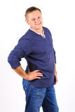 Casually dressed middle aged man in jeans and smiling Royalty Free Stock Images