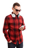 Casually dressed student texting. A portrait of a casually dressed student texting, isolated on white background Stock Photos