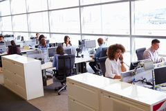 Casually dressed workers in a busy open plan office Stock Image
