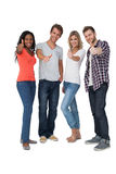 Casually dressed young people gesturing thumbs up Stock Photography