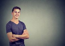 Casually handsome confident young man in t-shirt keeping arms crossed stock images