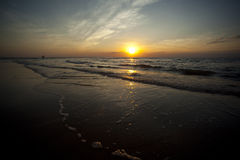 Casuarina Beach at Sunset, Darwin. Small Waves Wash on Beach, Casuarina Beach, Darwin - Close to Sunset Stock Image