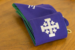 Casula purple. On a wooden table ,and a white cross on casula Royalty Free Stock Photo