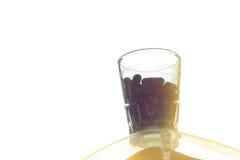 Casulepillen in het glas Royalty-vrije Stock Afbeeldingen