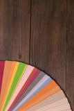 Catálogo da cor na mesa de madeira Foto de Stock Royalty Free