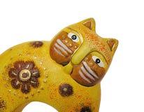 Cat. Yellow ceramic cat stock photos