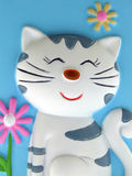 Cat. Smiling cat with flowers from ceramics royalty free stock image