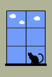 Cat. Silhouette of a cat sitting in front of a window enjoying the view Royalty Free Stock Images