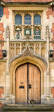 Cat. At the front door of the Master's lodge at Selwyn college, Cambridge university, England Royalty Free Stock Photo