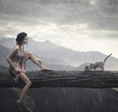 Cat. Young woman and cat on a trunk stock image