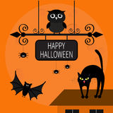 Cat arch back. Kitty on roof. Flying bats, owl, spider. Wrought iron sign board. Happy Halloween card.  Stock Images