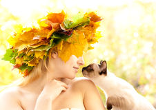 Cat and autumn nymph Royalty Free Stock Photos
